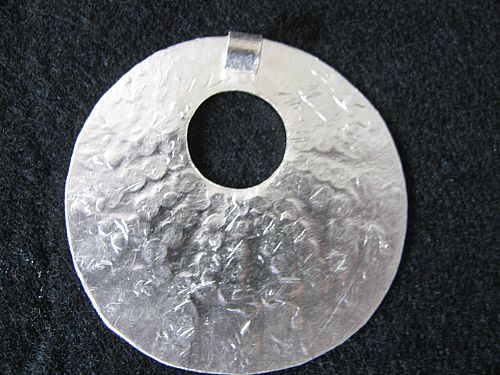 Photo of our Silver tribal circle pendant