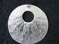 Photo 3 of our Silver tribal circle pendant