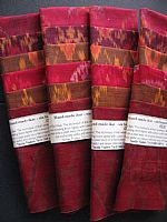 Photo of our Reds, purples and bronzes ikat sample set