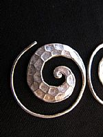 Photo 2 of our Beaten Spiral earrings