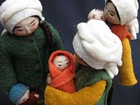 Photo 4 of our Yuliya (felt doll with toddler at her side)