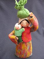 Photo 1 of our Sasha - felt doll with bundle and child