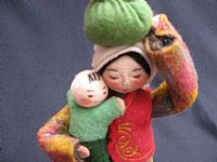 Photo 2 of our Sasha - felt doll with bundle and child