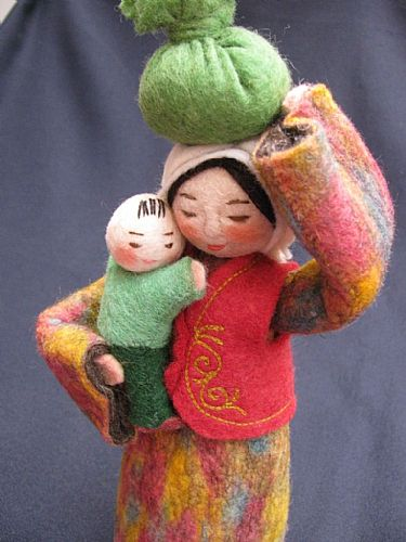 Photo of our Sasha - felt doll with bundle and child