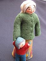Photo 5 of our Yuliya (felt doll with toddler at her side)