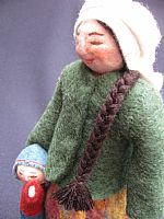Photo of our Yuliya (felt doll with toddler at her side)