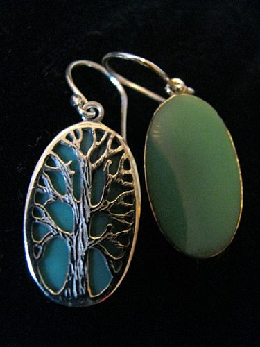 Photo of our Oval Tree of Life silver earrings