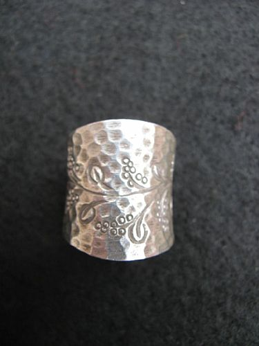 Photo of our Floral wide silver ring