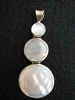 Photo of our Pearly shell and silver pendant