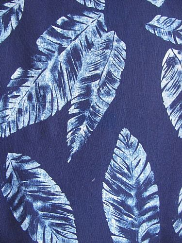 Photo of our Cotton Indigo Print. Scattered leaves design