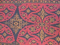 Photo 2 of our Burgundy and Black ikat fabric