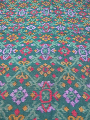 Photo of our Deep dark green and turquoise ikat fabric
