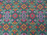 Photo 3 of our Deep dark green and turquoise ikat fabric