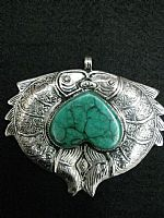 Photo of our Double Fish Turquoise pendant