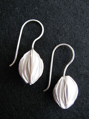 Photo of our Silver seed pod design earrings